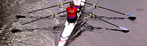 Two people in a rowing boat.