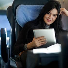 Woman looking at her finances on the move
