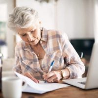 Woman reviews her pension and retirement savings