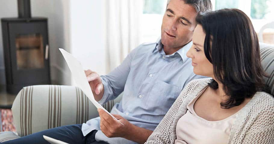 A couple reviewing their finances at home.