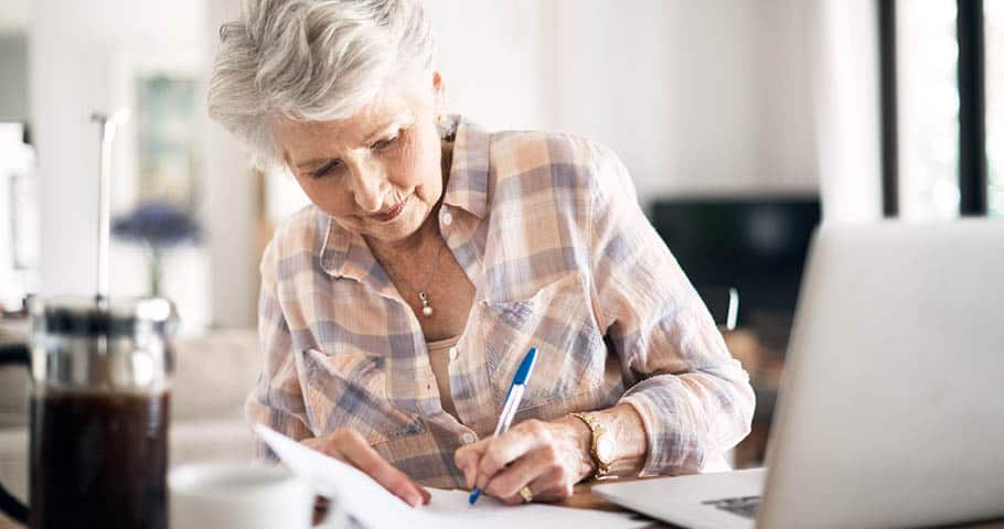 A retiree reviewing her retirement income