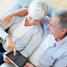 An older couple looking at their pension finances