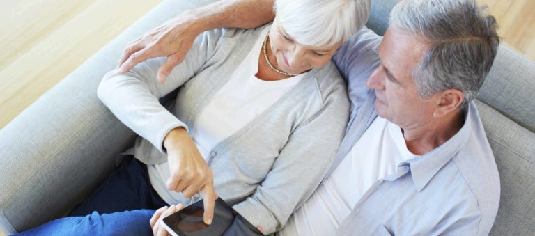 An older couple reviewing their pension finances