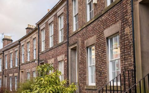 A row of houses representing inheritance tax IHT