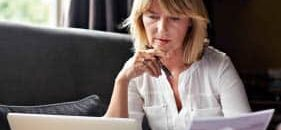 A woman reviews her pension online