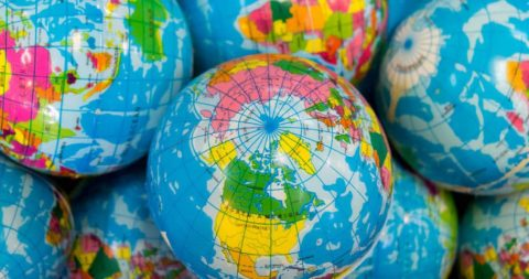 A collection of globes highlighting different investment areas