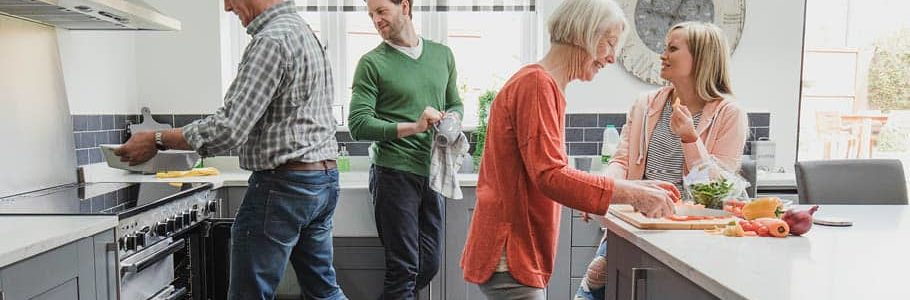 Retired parents cooking with their children