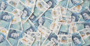 New English plastic five pound note background.