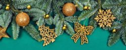 New year and Christmas concept. Frame of Christmas branches decorated with gold balls and toys. Flat lay, top view, copy space.